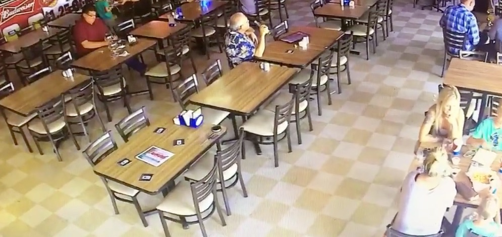 Still from CCTV showing eating area and chair moving