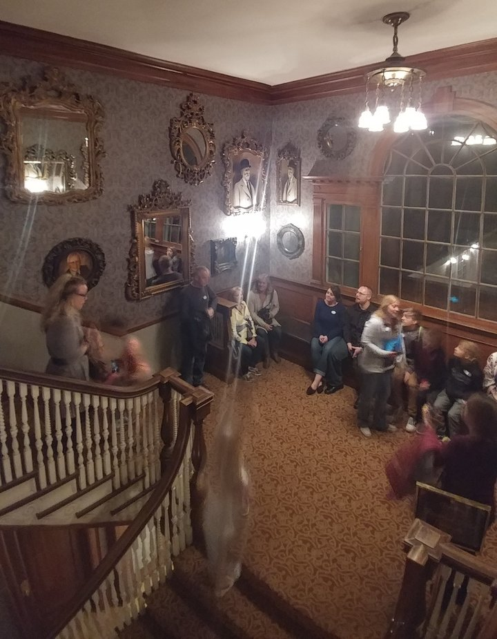 Full photo of the Stanley Hotel group and the two ghostly figures