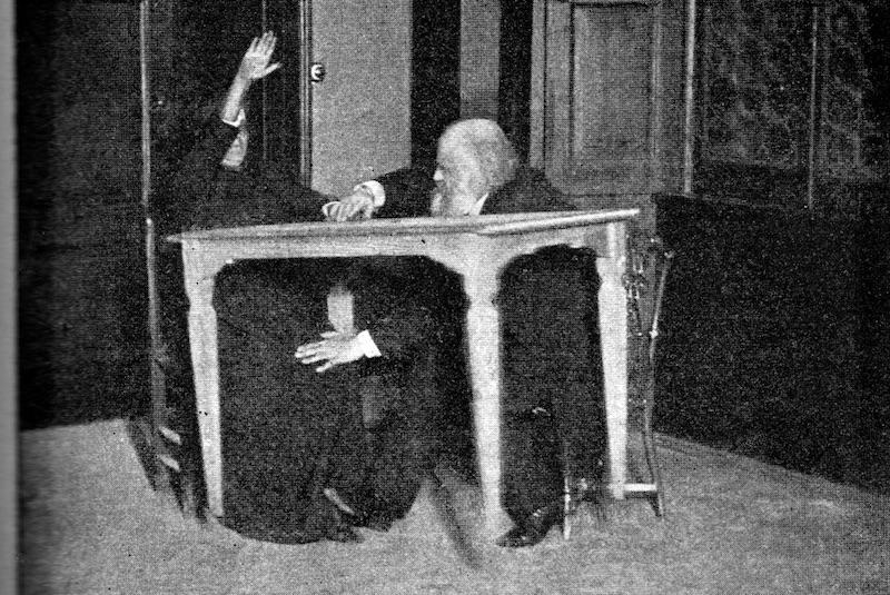Eusapia Palladino 'levitating' a table